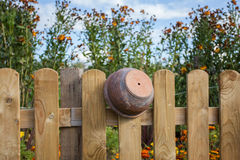 Clay pot on the fence Royalty Free Stock Photography