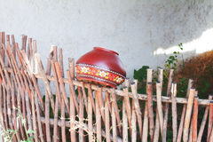 Clay pot on the fence Stock Photo