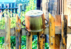Clay pot on the fence Royalty Free Stock Images