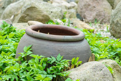 Clay pot in flower bed Royalty Free Stock Photography