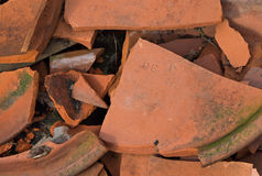 Clay Pot Fragments with Moss. Close-up of shattered clap pot fragments, some with moss rowing on them stock images
