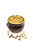 Clay pot full of coins Stock Photo