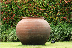 Clay pot in the garden Stock Photos