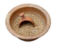 Clay pot with grains Stock Image