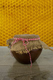 Clay pot with honey on rustic wooden background Royalty Free Stock Images