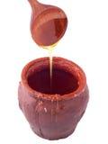 Clay pot with honey Stock Photo