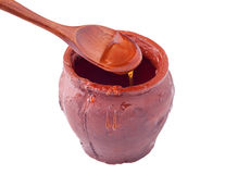 Clay pot with honey Stock Photography