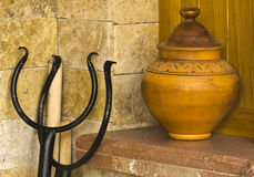 A clay pot. Clay pot in the kitchen for decorative purposes Royalty Free Stock Photos