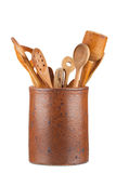 Clay pot with kitchen utensils Stock Images
