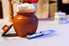 Clay pot and knife Royalty Free Stock Images