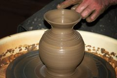 The clay pot made hands of the person Royalty Free Stock Images