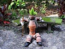 Clay Pot Man en jardín Imagen de archivo libre de regalías