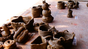 Clay pot. The many classical clay pot and glass on the floor Royalty Free Stock Photography