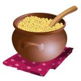 Clay pot with millet porridge in it Stock Images