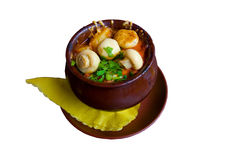 Clay pot with mushrooms on top. Photo of a food served in clay pot with mushrooms on top Stock Images
