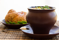 Clay pot on a napkin with seasame bread Royalty Free Stock Photos