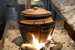 Clay pot over fire Stock Photography