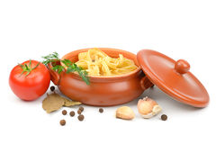 Clay pot with pasta Stock Images
