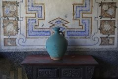 A clay pot placed on an old table royalty free stock images