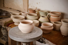 Clay pot on a potter`s wheel. Close-up. Copy spase stock image