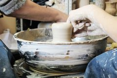 Clay pot on potter`s wheel working process stock photography