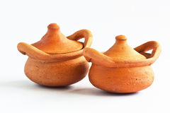 Clay pot for rice cook. Royalty Free Stock Photo
