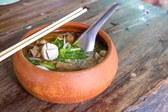 Clay pot rice noodles put on a wooden table royalty free stock photos