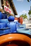Clay pot Store. A photo of a group of blue pots outside of a pottery store stock image
