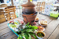 Clay pot.Thai traditional spicy shabu shabu, dipping meat in boi Royalty Free Stock Photography