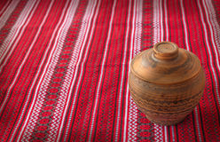 Clay pot on the Ukrainian homespun fabric Stock Image