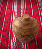 Clay pot on the Ukrainian homespun fabric Stock Images