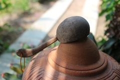 Clay pot and water ladle  Made from coconut shell  Vintage Asian style water holder stock photo