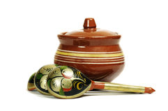 Clay pot with wooden spoons Stock Images