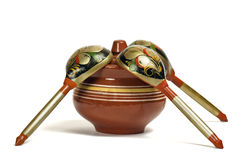 Clay pot with wooden spoons Royalty Free Stock Image