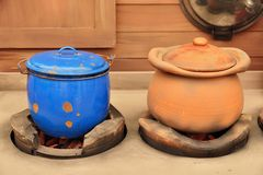 Clay pot and zinc on stove. Royalty Free Stock Photo