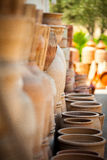 Clay pots. Row of ready to sell clay pots Stock Images