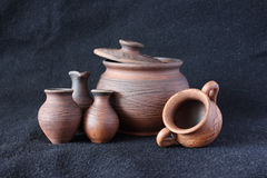 Clay pots. On a dark background Stock Images