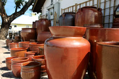 Clay pots. A photo of a group of orange pots outside of a pottery store royalty free stock photography