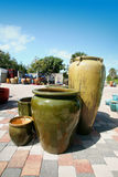 Clay pots. A photo of a group of green pots outside of a pottery store Stock Photos