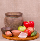 Clay pots, apple, meat pork Stock Photo