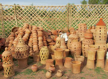 Clay pots in arabic market. Clay pot, decotation pot standing on green grass outside. decorative clay pot with handle. Clay pots in arabic market Royalty Free Stock Images