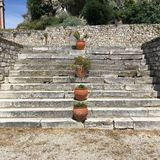 Clay pots ascending stone steps at the Old Fortress, Corfu Town, Greece Royalty Free Stock Images