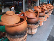 Clay pots, Bangkok, Thailand. Clay pots used for cooking in a restaurant, heated at your table Stock Photos