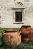 Clay pots and church wall. Heresti, Romania, April 5, 2009: Old clay pots near to a church wall Stock Images