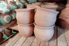 Clay pots drying on a shelf in the pottery royalty free stock image
