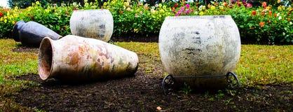 Clay pots in garden. Earthenware pots in a garden of flowers Stock Photography
