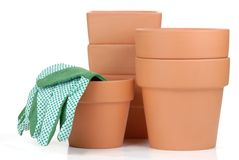 Clay pots with gloves Royalty Free Stock Photography
