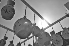 Clay pots hang in the sunshine royalty free stock image