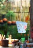 Clay pots hanging. Colorful clay pots hanging in garden Stock Photos