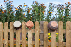 Clay pots hanging on the fence Stock Image